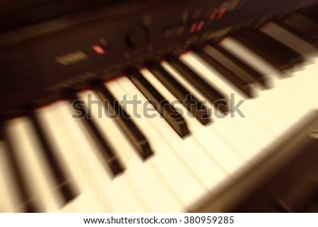 Blurred piano background.