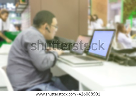 Blurred Picture of Business Man Using Laptop for Working - Business and Technology Concept