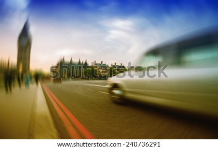 Blurred picture of fast moving car in Westminster, London. - stock photo