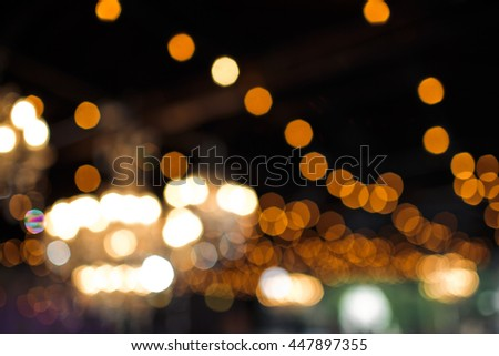 Blurred picture of lights on the restaurant's ceiling - stock photo