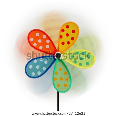 Blurred pinwheel isolated in white background. Fron wheel is sharp. - stock photo