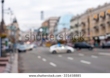Blurred police car on the street at night. Blur city background. - stock photo