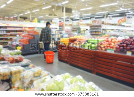 Blurred produce section at a supermarket in Toronto, Canada