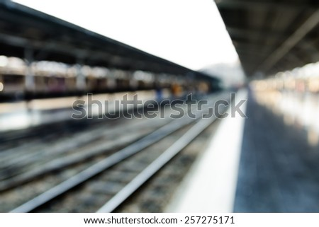 Blurred railroads in train station as a background - stock photo