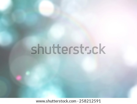 Blurred rainbow on natural abstract background with bokeh and sun flare  - stock photo