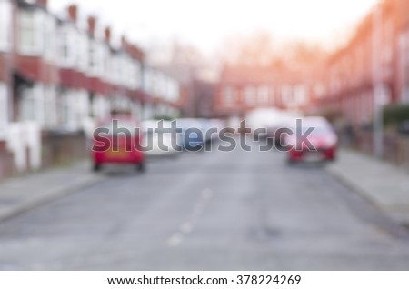 Blurred road with cars and houses in Manchester, England. - stock photo