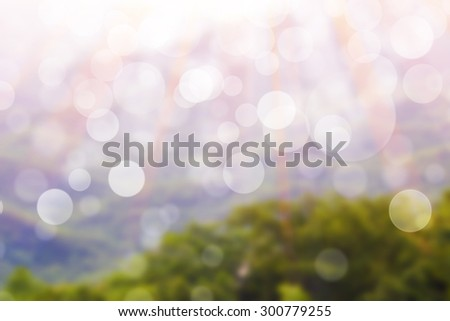 blurred scenic view of mountain with mist. - stock photo