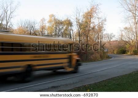 Blurred school bus against focused background - stock photo