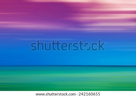 Blurred sea horizon. One third of the image is green, one third is blue and one third is purple. - stock photo