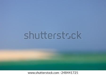 Blurred sea, sky and beach background - stock photo