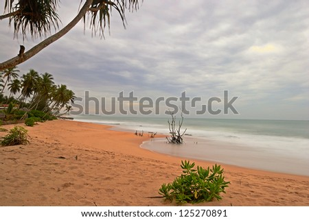 Blurred seascape, long exposure taken on a tropical beach during monsoon time at dusk - stock photo