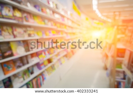 Blurred Shop Background in Book store Shelf Natural bokeh out of focus Bookstore,Blur background of people in library book store,shopping mall background concept,vintage color - stock photo