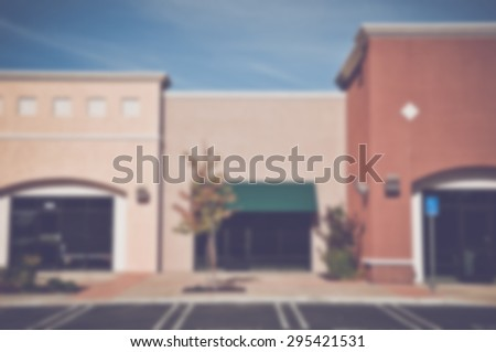 Blurred Shopping Center Store Front with Instagram Style Filter - stock photo