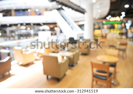blurred shopping mall - seat and table blur background - stock photo