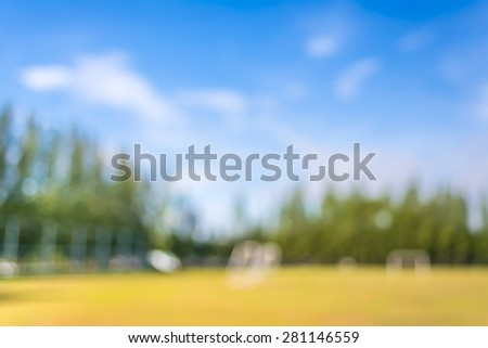 blurred shot of soccer field at school on day time image for background usage. - stock photo