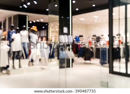 Blurred showcases fashion boutique with clothes. Blurred bokeh basic background for design. - stock photo