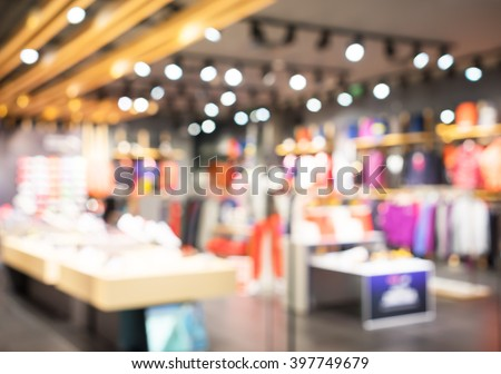 Blurred showcases fashion boutique with sportswear . Blurred bokeh basic background for design. - stock photo