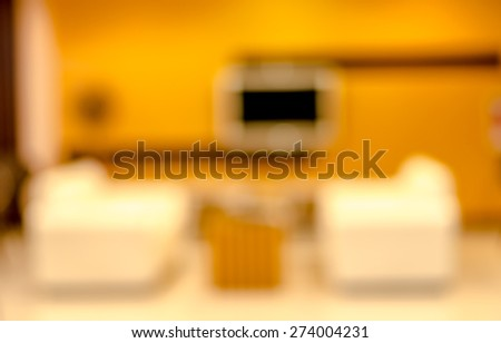 Blurred sofa in hotel drawing room - stock photo