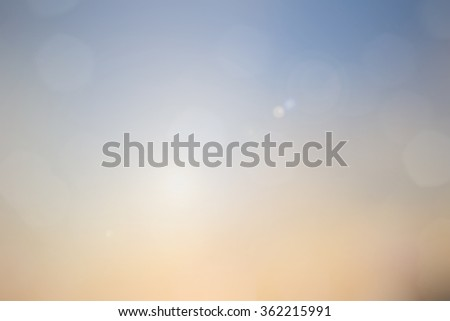 Blurred soft colored bright background of nature sky outdoor aerial with circle bulbs  lights.abstract morning sunny hour backdrop:sunshine glint illuminated sun rays.motion  bokeh light display. - stock photo