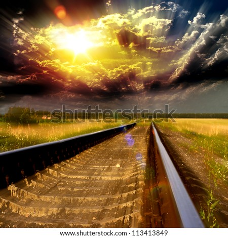 Blurred speedway railroad into the sunset - stock photo