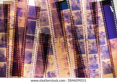 Blurred stack of old films on the light background. - stock photo