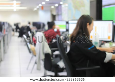 blurred students or employees working or learning about program at the computer:blur group of people monitoring computer concept:blurred of people,education,business and technology concept. - stock photo