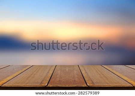 Blurred Sunrise Background, Early Morning Light with Wooden Table.