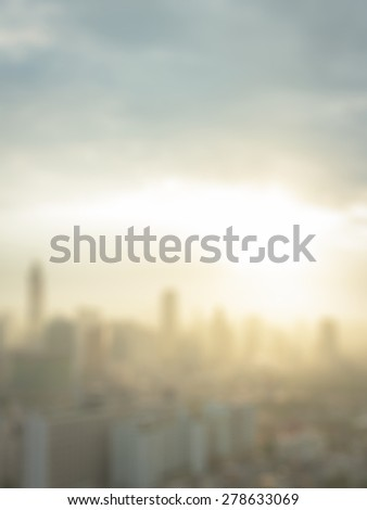 Blurred sunrise over city background. World City Day, Africa Industrialization Day concept. - stock photo