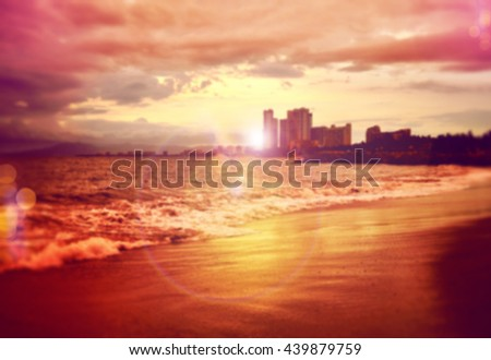 Blurred sunset beach in Puerto Vallarta Mexico, background ready for your design. - stock photo