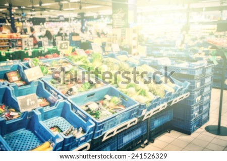 Blurred supermarket background with copyspace  - stock photo