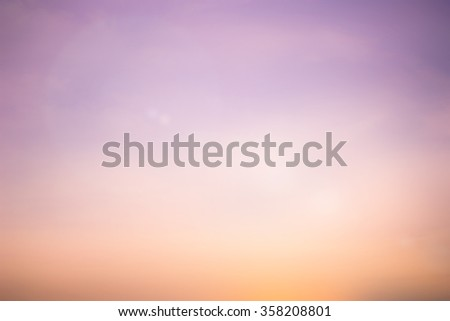 Blurred sweet colored toned bright background of evening nature firmament with lens flare lights.abstract gold hour dusk backdrop:shimmer glint shine illuminated sun ray.soft clouds colored display - stock photo