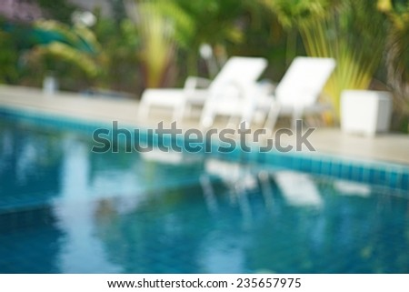 blurred swimming pool and white pool bed  useful for background - stock photo
