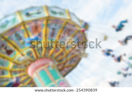 Blurred swinging ride at a carnival - stock photo