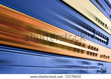 Blurred telecommunication equipment. High speed internet. - stock photo