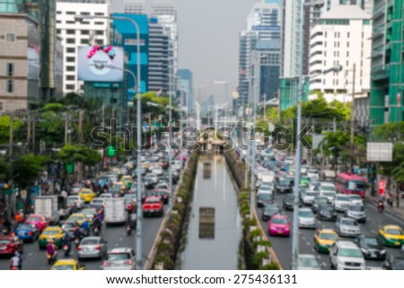 Blurred traffic jam in Bangkok with pollution in evening - stock photo
