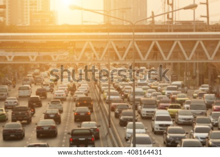 blurred traffic jam with sunset light on  the road in bangkok ,thailand, Motion blur - stock photo