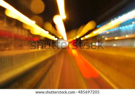 Blurred traffic lights in motion, abstract urban background
