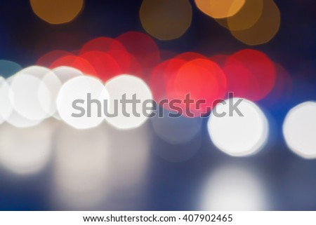 blurred traffic lights in night - stock photo