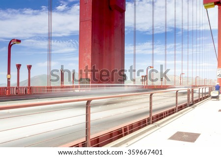 Blurred Trails of Cars and People Passing By on The Golden Gate Bridge in San-Francisco in the Afternoon.Horizontal Image Orientation