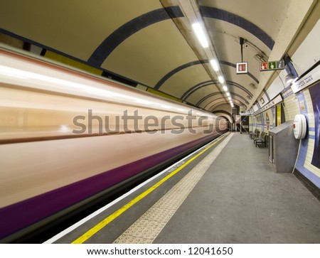 Blurred train arriving at Candem subway station, London. - stock photo