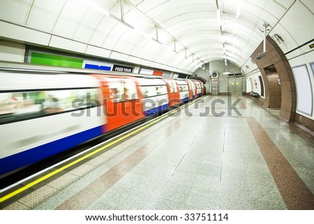 Blurred train arriving at subway station - stock photo