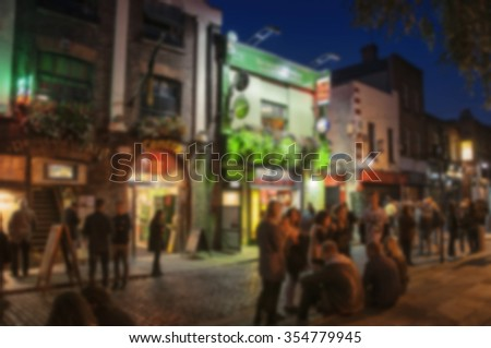 Blurred travel backgrounds - Nightlife at popular historical part of Dublin, Ireland - Temple Bar quarter. The area is the location of many bars, pubs and restaurants - stock photo