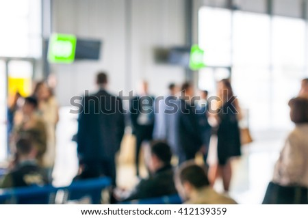 Blurred travelers people at Airport. Summer travel concept - stock photo