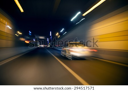 Blurred tunnel traffic - stock photo
