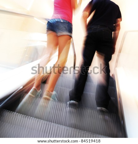 blurred unrecognizable people in motion in a shopping mall - stock photo