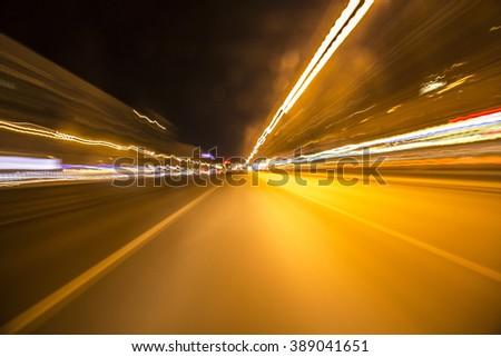 blurred urban look of the car movement nights longexposure - stock photo