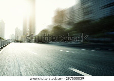 Blurred urban road in modern city - stock photo
