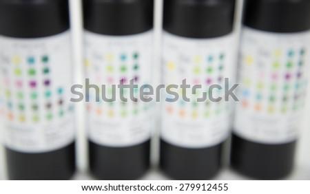 blurred urine test strips. - stock photo