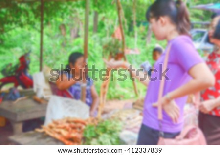 Blurred vegetable market buyer bargain with sellers local market asian style - stock photo