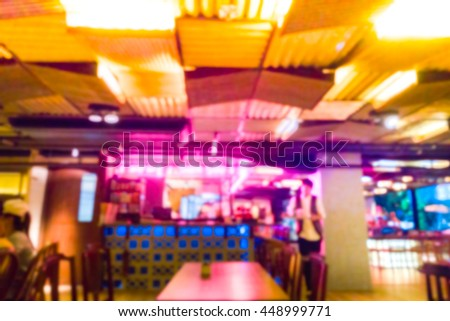 blurred vibrance color background of cafe interior in night time with lighting